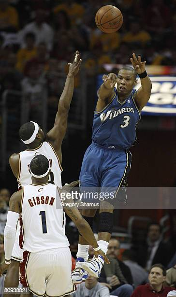 Caron Butler of the Washington Wizards passes over Devin Brown and Daniel Gibson of the Cleveland Cavaliers during Game Five of the Eastern...