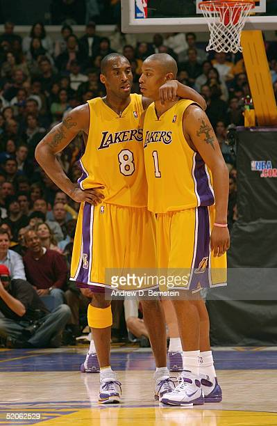 Caron Butler talks with Kobe Bryant of the Los Angeles Lakers during the game against the Houston Rockets on January 7 2004 at the Staples Center in...