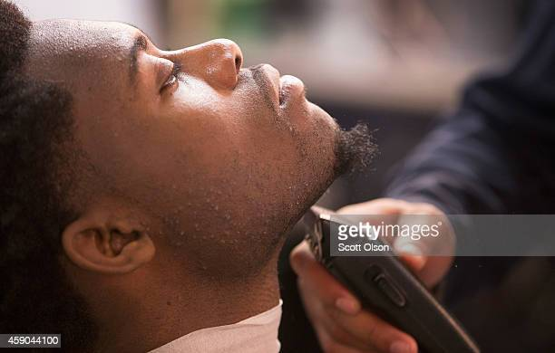 Caron Payne get his beard trimmed at the Prime Time Barber and Beauty shop on West Florissant Street November 15 2014 in Ferguson Missouri Business...
