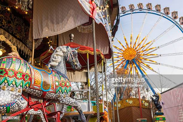 carousel at a carnival or festival with a ferris wheel. - istock photo stock pictures, royalty-free photos & images