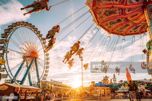 carousel at the oktoberfest in munich, germany - oktoberfest stock pictures, royalty-free photos & images