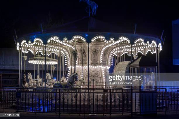 a carousel by night - heinovirta stock pictures, royalty-free photos & images
