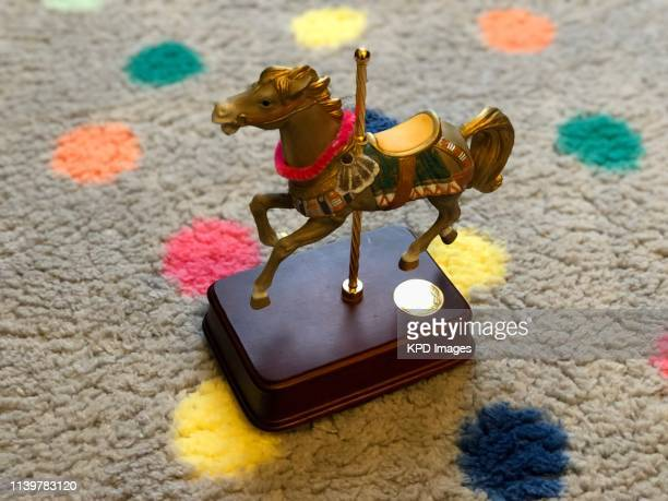 carousel horse music box on polka dotted carpet - music box stock pictures, royalty-free photos & images