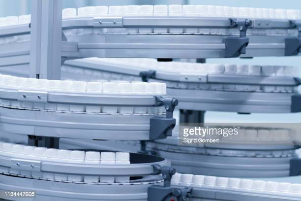 carousel of pharmaceutical containers - sigrid gombert stock-fotos und bilder