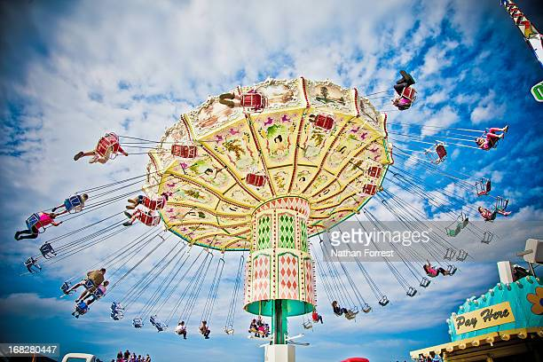 CONTENT] A carousel ride spinning framed by blue skies at the Epsom Derby for the Queen's Diamond Jubilee weekend