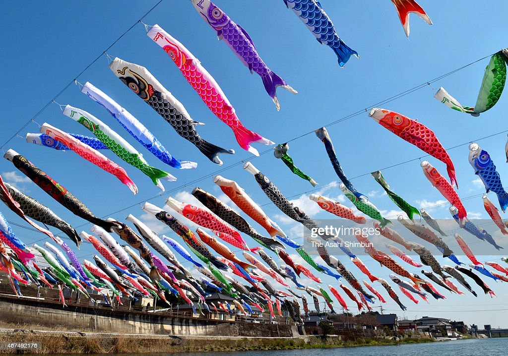 Carp streamers are hung over the Kawakamikyo Valley on March 25, 2015 in Saga, Japan. People pray for the health and future success of their sons by hanging up carp streamers ahead of May 5, deriving from a Chinese folk tale that a carp becomes a dragon once it successfully swim up the waterfall.