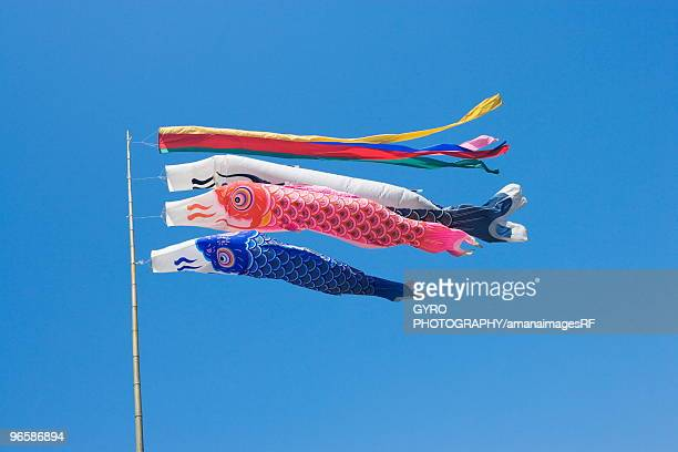 Carp streamers in sky, blue background
