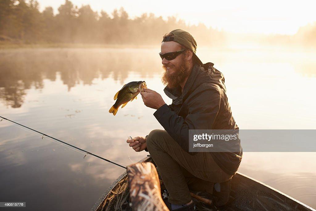 Carpe diem…seize the fish : Stock Photo