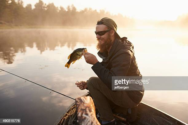 carpe diem…seize the fish - lake auburn stock photos and pictures