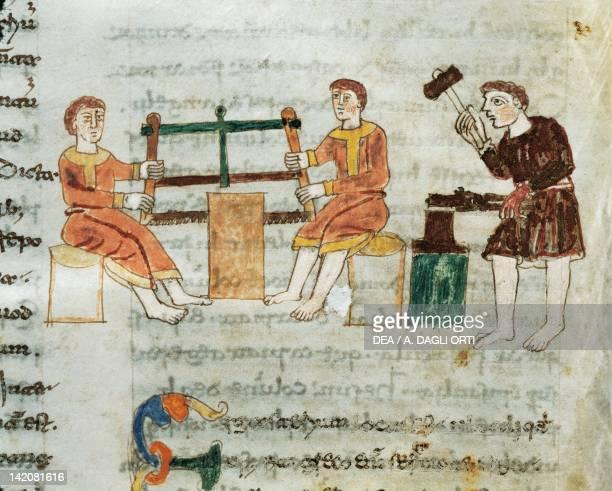 Carpenter and blacksmith miniature from De universo by Rabano Mauro manuscript Italy 11th Century