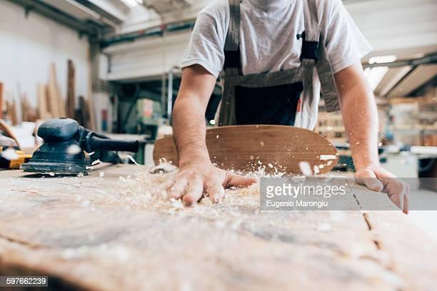 Carpenter and wood shavings from skateboard