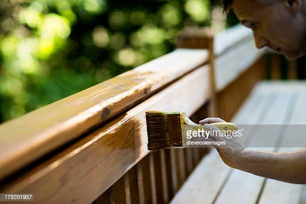 Carpenter Applying Varnish To Wooden Furniture.