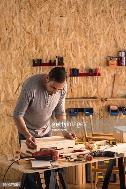 Carpenter at work in his woodshop