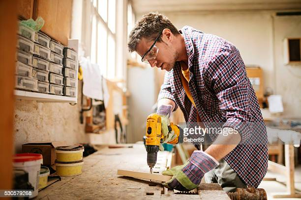 carpenter at work - drill stock pictures, royalty-free photos & images