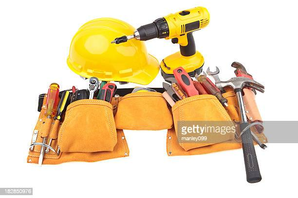 carpenter belt with tools, hardhat and power tool