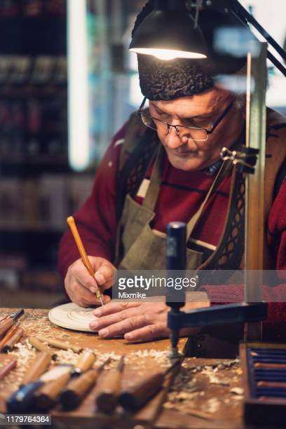 carpenter carving wooden decorative figurine - carving craft product stock pictures, royalty-free photos & images