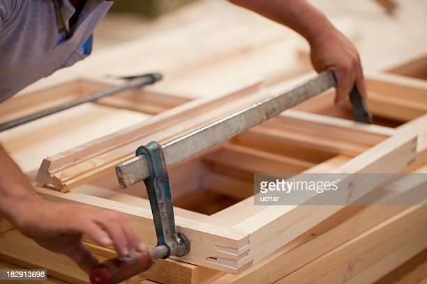Carpenter constructing window frame