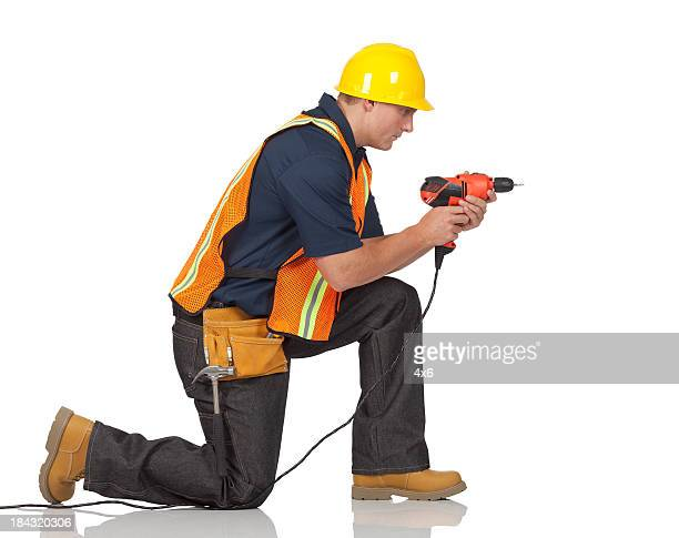 carpenter drilling with a hand drill machine - drill stock pictures, royalty-free photos & images