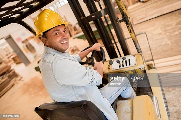 Carpenter driving a vehicle