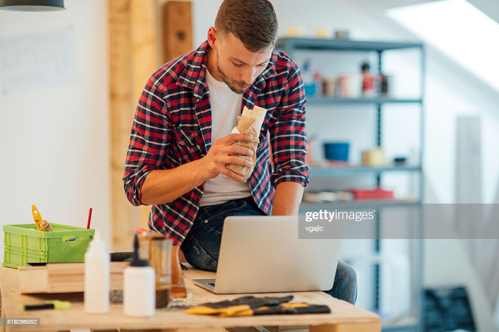 Carpenter Eating Sandwich At Work. : Stock Photo