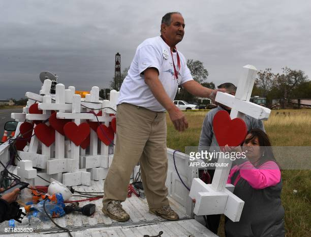 Carpenter Greg Zanis who drove from Chicago unloads his crosses outside the First Baptist Church which was the scene of the mass shooting that killed...
