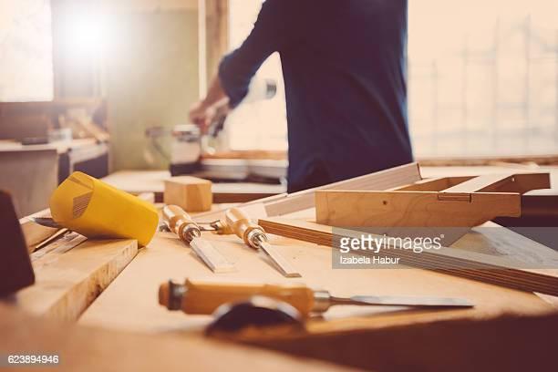 Carpenter in a construction workshop
