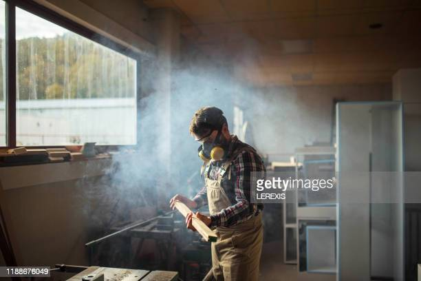 carpenter in a furniture workshop - small business stock pictures, royalty-free photos & images