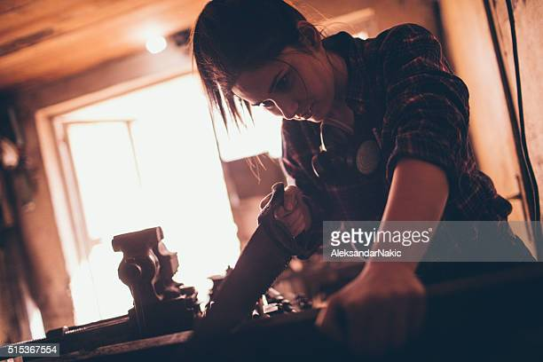 Carpenter in her workshop