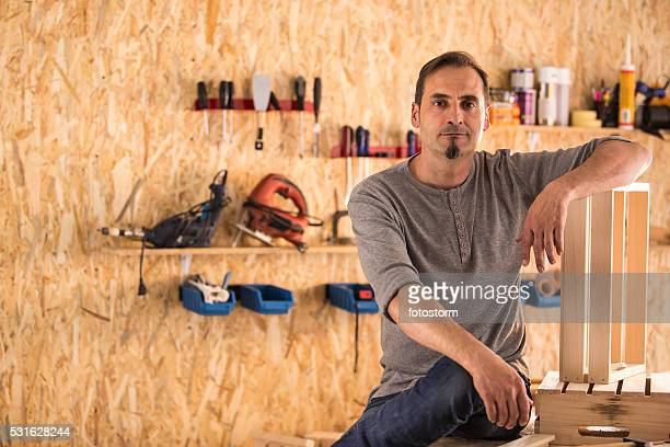 Carpenter in his furniture shop