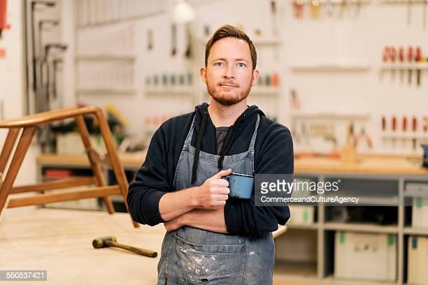 carpenter in wood workshop