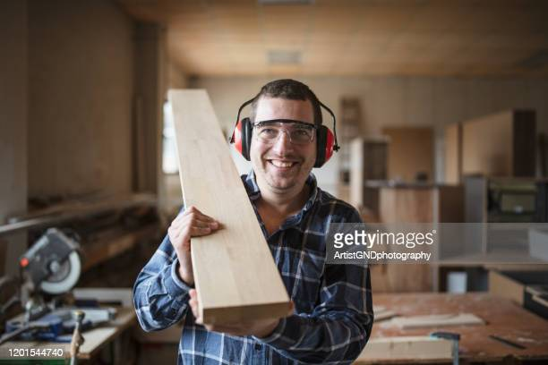carpenter in workshop - carpenter stock pictures, royalty-free photos & images