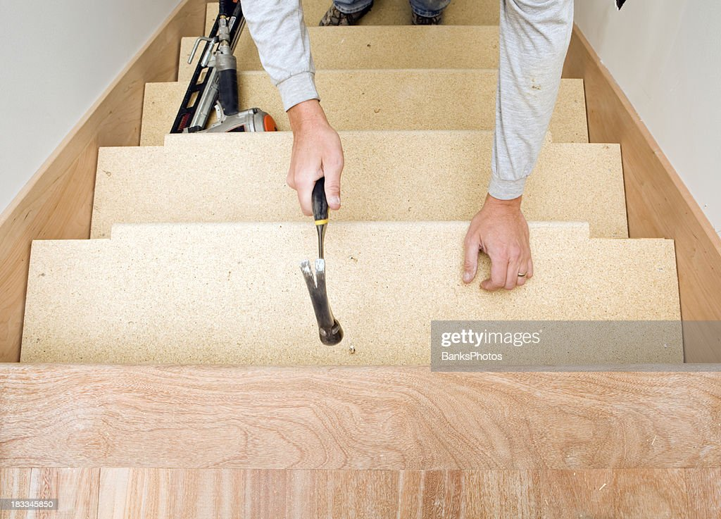 Carpenter Installing Particle Board Stair Tread : Stock Photo