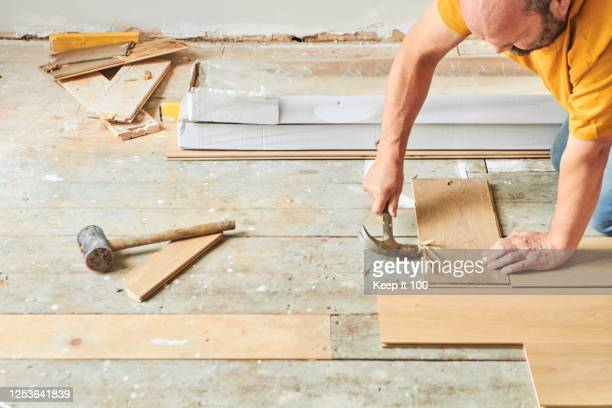 carpenter laying new wood flooring - new stock pictures, royalty-free photos & images