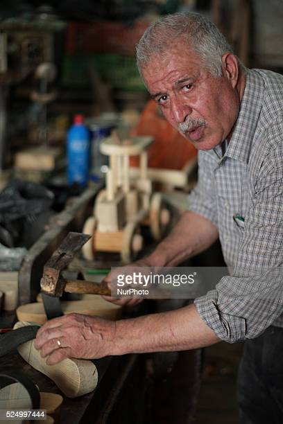 A carpenter makes a wooden sandals in his workshop in the old town of Nablus city West Bank on May 31 2015 Nablus city northern of the Palestinian...