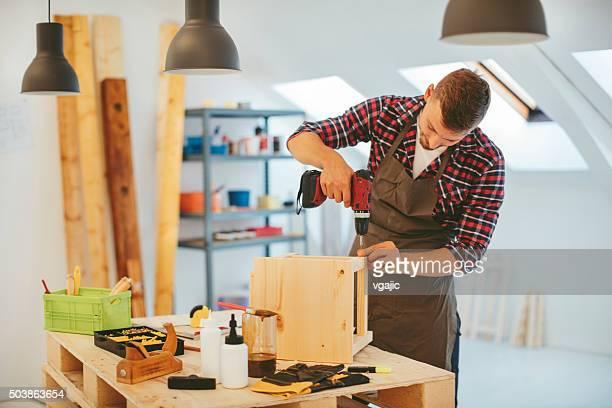 Carpenter making chair