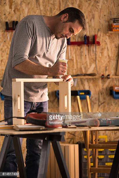 Carpenter making wooden product