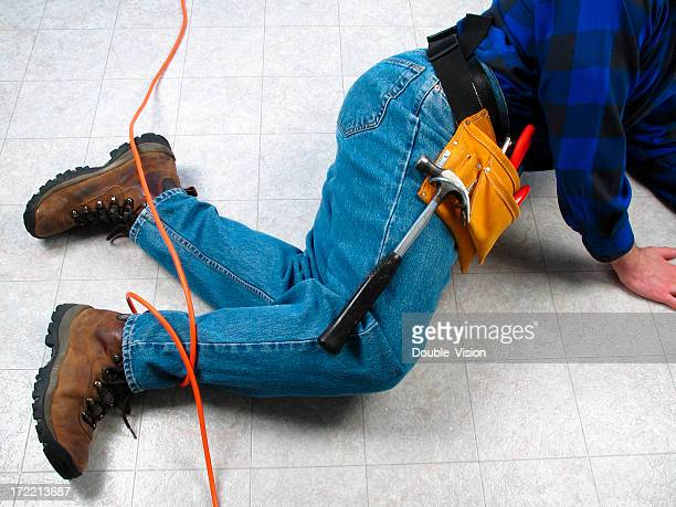 Carpenter or Construction Worker Tripping on Orange Extension Cord