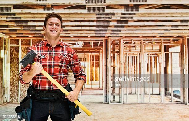 Carpenter posing with hammer