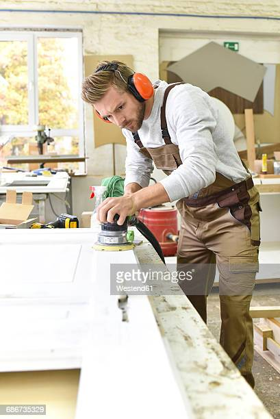Carpenter restoring a wooden door