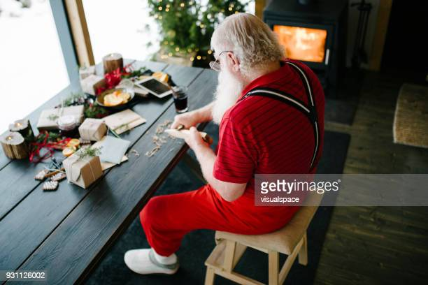 carpenter santa claus - santas workshop stock photos and pictures