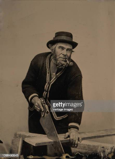 Carpenter Sawing a Plank of Wood, 1880s-90s. Artist Unknown.