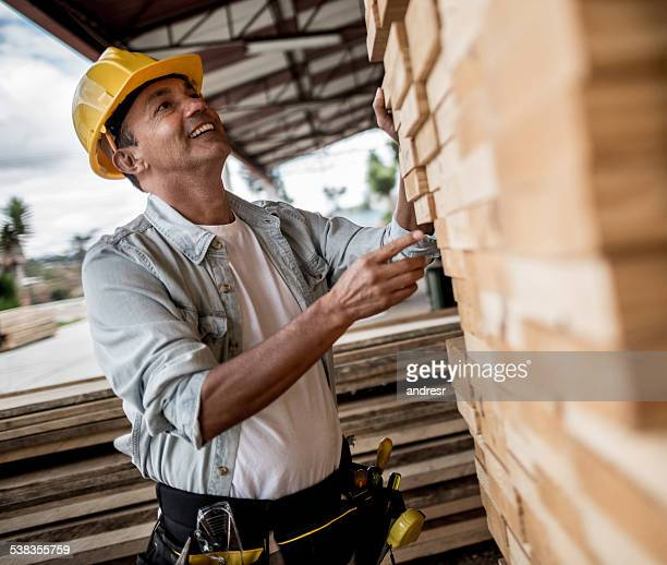 Carpenter selecting wood to work with
