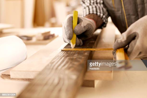 carpenter taking perfect measurement - building contractor stock pictures, royalty-free photos & images