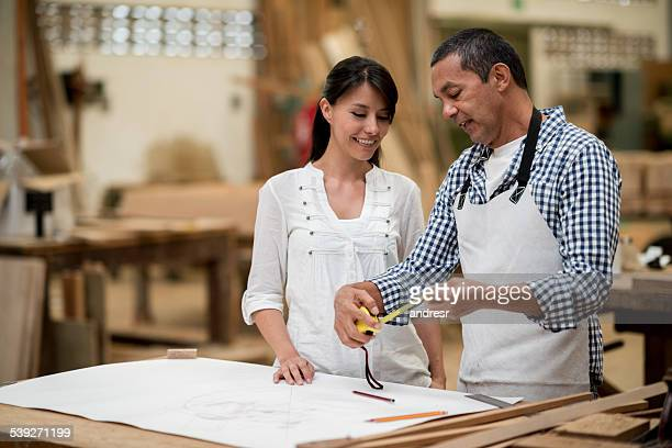 Carpenter talking to a client