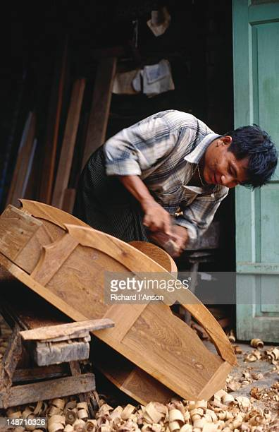 carpenter u thein naing works on new sidecar body at sein pe furniture workshop. - thein sein stock pictures, royalty-free photos & images