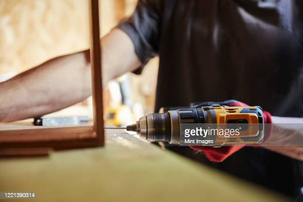 carpenter using a hand drill - manual worker stock pictures, royalty-free photos & images
