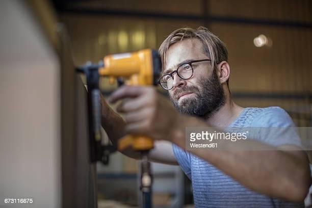Carpenter using a staple gun