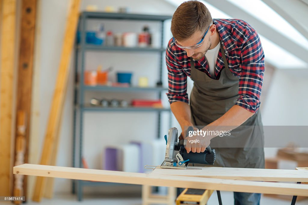 Carpenter Using Circular Saw In His Workshop. : Stock Photo