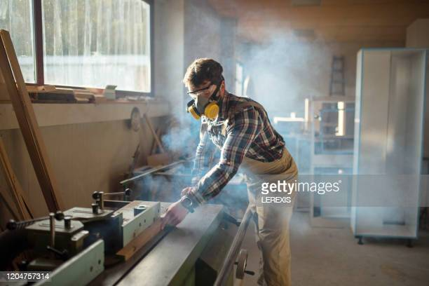 carpenter with mask and glasses in smoke - toughness stock pictures, royalty-free photos & images
