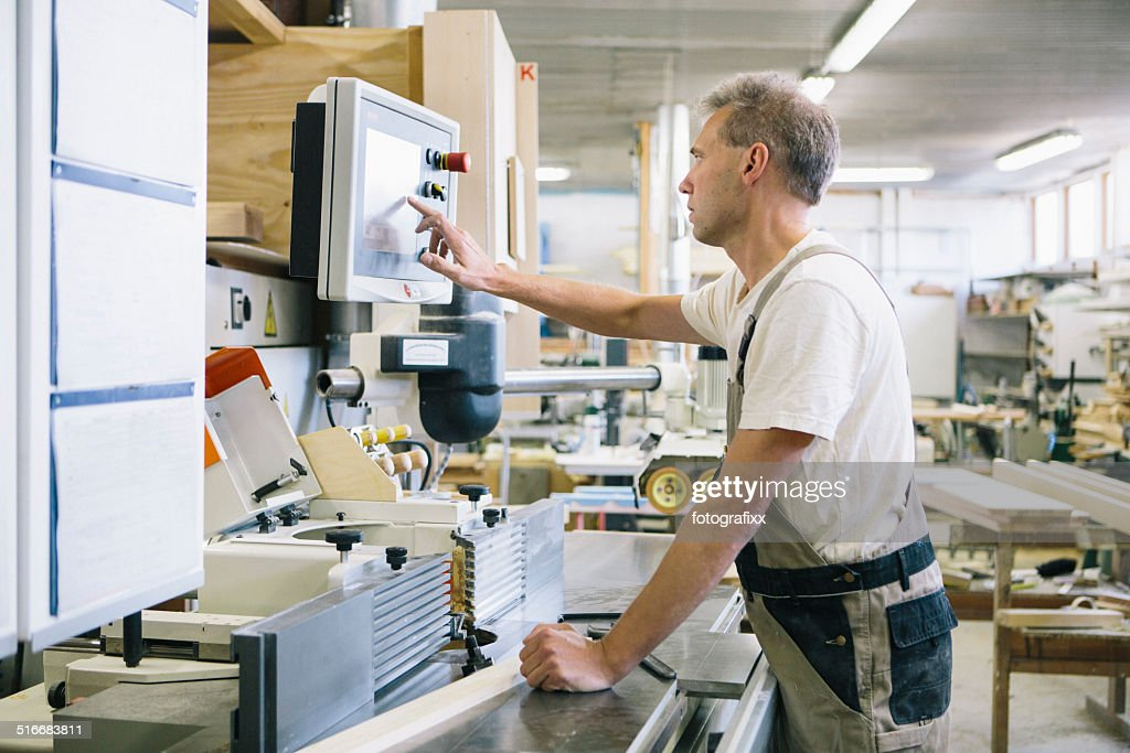 carpenter working at Electric Saw : Stock Photo